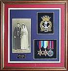 Framed medal display with badge, medals and photograph